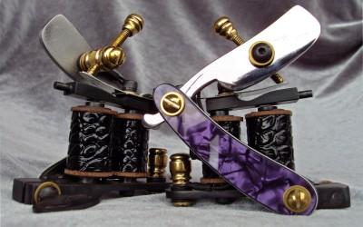 Set of 2 purple / white pearl razor blade liners.